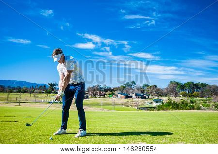 Golfer Playing A Shot On The Fairway