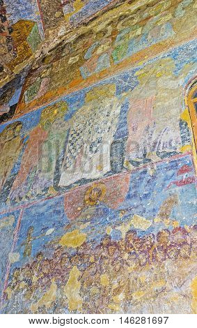 VARDZIA GEORGIA - MAY 27 2016: The preserved frescoes on frontage wall of Dormition Church the main landmark of archaeological site on May 27 in Vardzia.