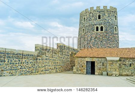 The huge stone watchtower of Rabati Castle with the renowated ramparts around it Akhaltsikhe Georgia.