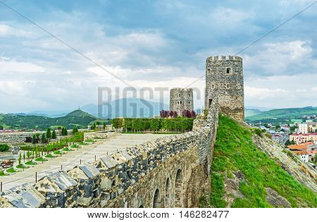 The long stone rampart with the battlements separates the Rabati Castle from the steep hill's and connects the tall watchtowers Akhaltsikhe Georgia.