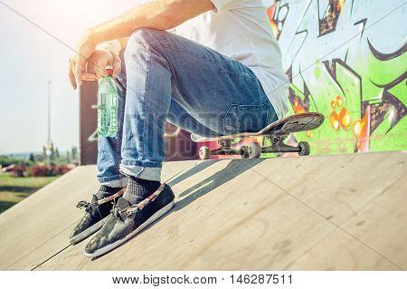 Skateboarder Sit Rest On Skatepark