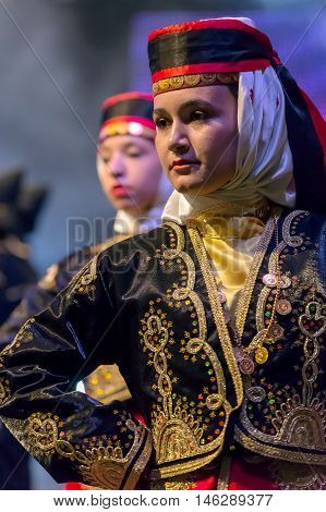 ROMANIA TIMISOARA - JULY 7 2016: Young Turkish dancers in traditional costume perform folk dance during