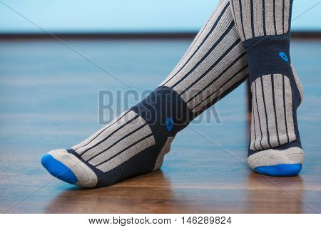 Woman Legs In Warm Sporty Socks On Floor