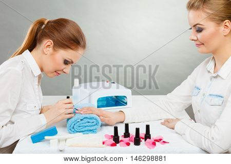 Professional Manicurist Painting Woman Nails.
