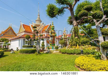Wat Arun Buddhist religious places in sunshine day Bangkok Thailand