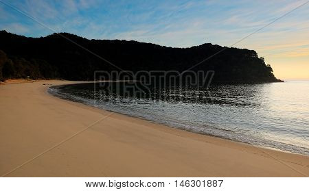 Sunrise on a Sandy Tropical Beach.  Te Pukatea Bay, Abel Tasman National Park, New Zealand