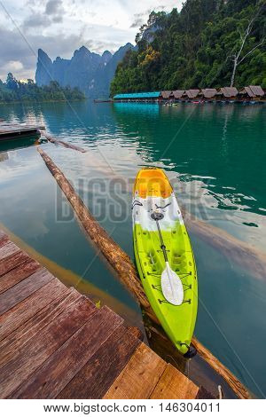 Canoe in a beautiful mountains lake forest and river natural attractions in Ratchaprapha Dam at Khao Sok National Park Surat Thani Province Thailand.