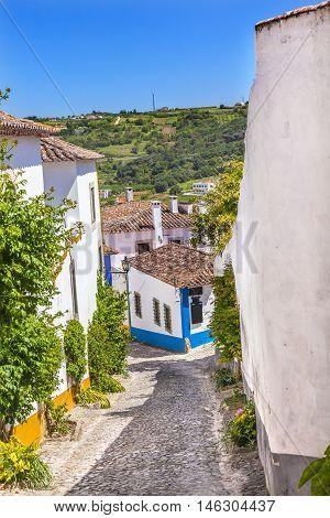 Narrow White Street 11th Century Medieval Town Farmland Obidos Portugal.