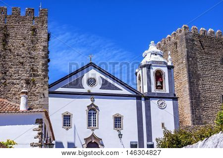 Sao Pedro Church Narrow White Street 11th Century Medieval Town Obidos Portugal. Church built in the late 13th/early 14th century. Castle and walls built in 11th century after town taken from the Moors.