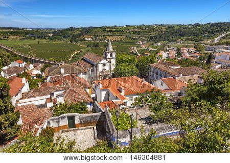 Santa Maria Church Castle Countryside Farmland Medieval Town Obidos Portugal. Castle and walls built in 11th century after town taken from the Moors.