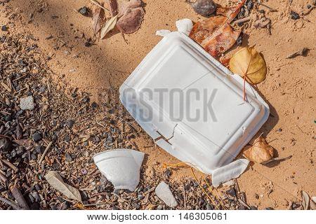 Close up foam litter on beach beach pollution environment.
