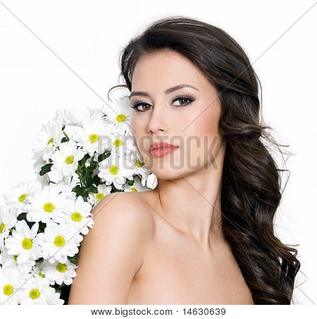 Young Sexy Woman And Flowers