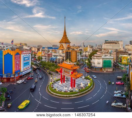 BANGKOK THAILAND - JANUARY 15 2016: Traffic passes through Chinatown at Odeon Roundabout. The roundabout marks one end of Chinatown.