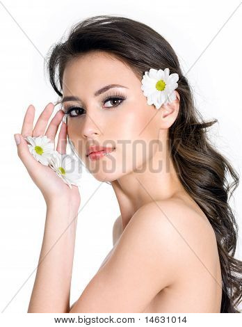 Woman With Fresh Clean Skin Of The Face And Flowers