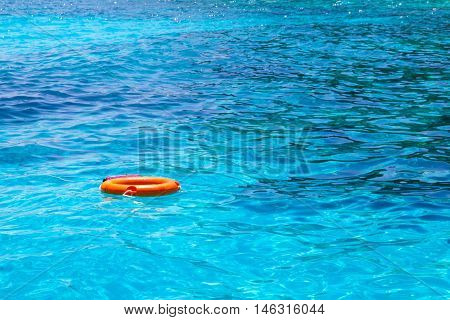 Lifebuoy in a stormy blue sea at Andaman Sea