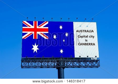 australia flag on billboard with capital city name - can use to education or montage on your product
