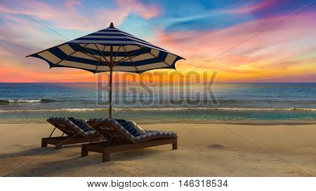3D Blue And White Umbrella On The Beach