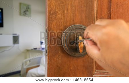 locksmith on old knob and wood door to open room - can use to display or montage on youe product