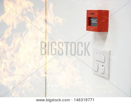 fire alarm on the wall and frame of fire filter