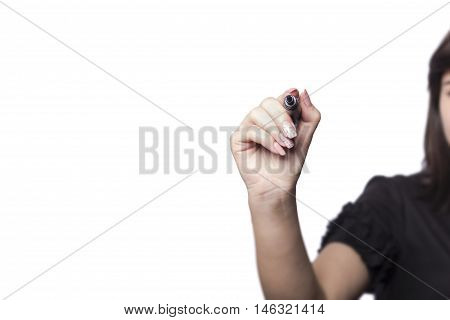 Writing with pen. Young beautiful businesswoman with pen writing on a screen / whiteboard. Focus on the black marker - lot's of copy space. Blond hair caucasian model isolated on seamless white background.