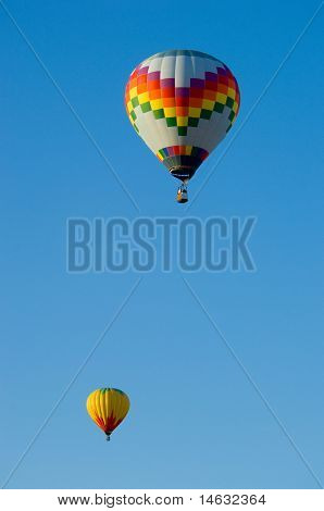Beautiful hot air balloons against dark blue sky with basket