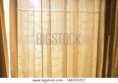 Gold or brown curtain in window curtain background