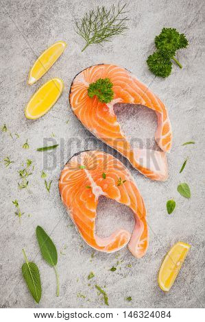 Fresh Salmon Fillet Slice On Dark Stone Background With Herbs Fennel ,sage ,rosemary Thyme,parsley A