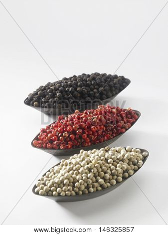 trio colorful peppercorn isolated on white background