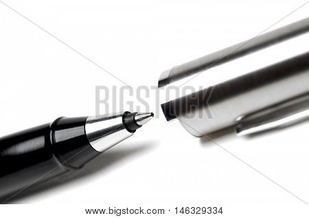 Ballpoint pen on white background, close-up