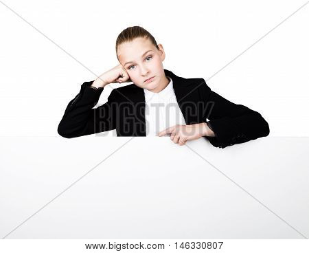 Little business woman standing behind and leaning on a white blank billboard or placard
