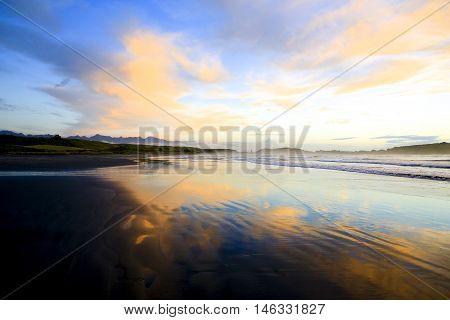 Sandy Beach At Sunset In Westport Of New Zealand.