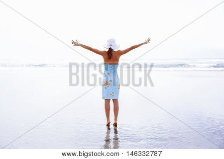 Happy Woman Silhouette With Hands Up. Westport, New Zealand.