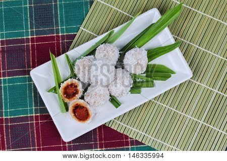 Steamed flour with minced coconut wrap sweet mashed coconut as