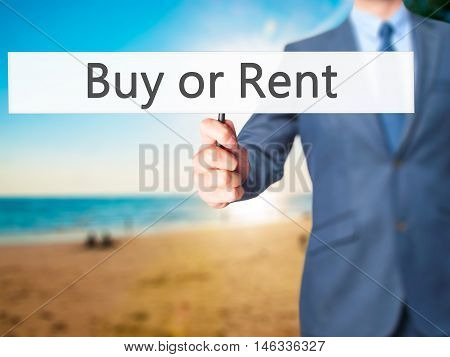 Buy Or Rent - Business Man Showing Sign