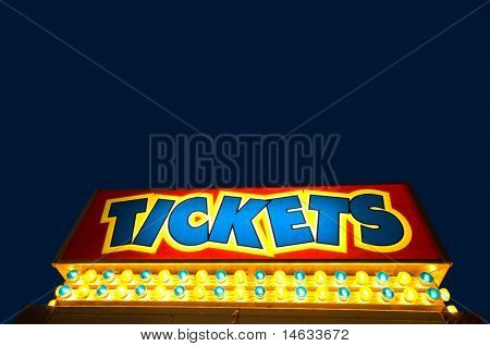 Ticket booth against dark blue dusky sky wit copy space above ticket message