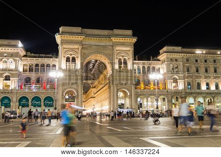 MILAN, ITALY - AUGUST 14, 2016: People walking in the Duomo Square by the gallery of Vittorio Emmanuil II during the night.