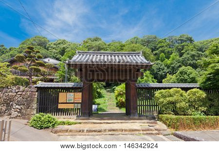 UWAJIMA JAPAN - JULY 22 2016: Noboritachimon Gate (circa 16th c.) of Uwajima castle Shikoku Island Japan. The oldest extant yakuimon style gate in Japan