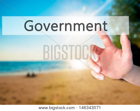 Government - Hand Pressing A Button On Blurred Background Concept On Visual Screen.