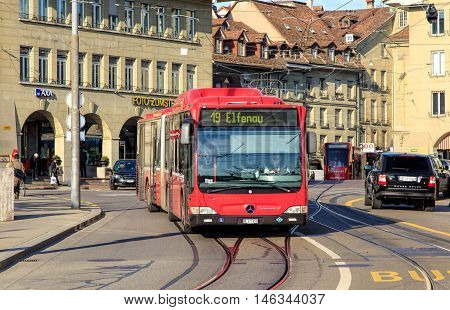 Bern, Switzerland - 29 December, 2015: pedestrians and traffic on Casinoplatz square. The city of Bern is the capital of Switzerland and the fourth most populous city in Switzerland.