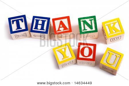 "A child's alphabet blocks on a white background spelling out the words ""thank you"""