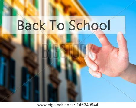 Back To School - Hand Pressing A Button On Blurred Background Concept On Visual Screen.