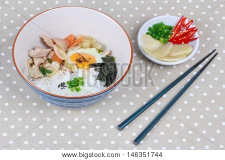 Rice is topped soft boil eggs and fried pork in Japanese style  as