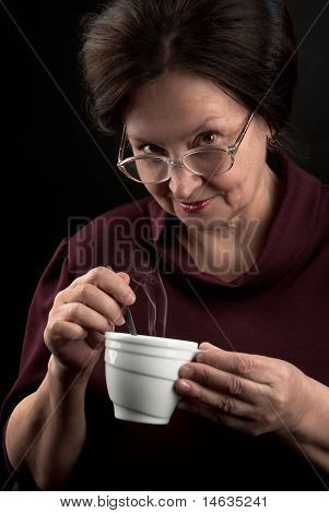 Smiling Woman with Cup Of Hot Drink