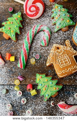 Christmas Ginger Cookies, Cane, Lollipop And Candy Strewn With Snow