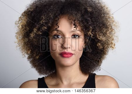 Young Black Woman With Afro Hairstyle On White Background