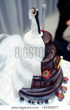 Beautiful wedding cake for bride and groom indoors. Colorful pie for celebration. Beauty of bridal interior for marriage