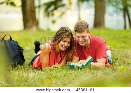 couple of students preparing for exam in the Park