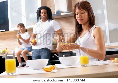 Mother cooking breakfast for her family