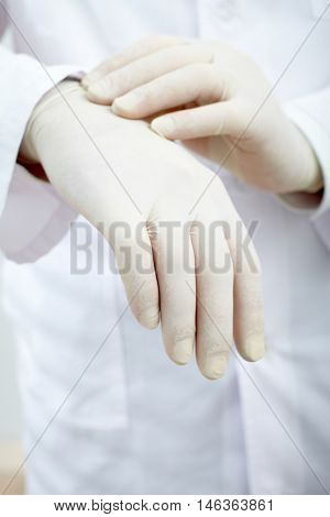 Close-up of hands in surgical gloves