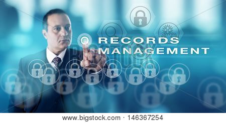 Information technology director with serious look is pressing a push button to call RECORDS MANAGEMENT. Content management metaphor and business administration concept for public and private sector.